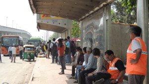 listeners at work at busy bus stop